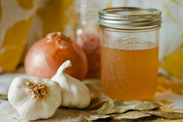 Picture of garlic, onions and a jar