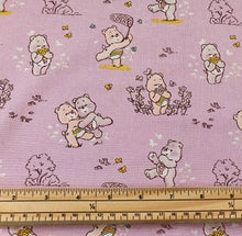 Care Bears Nursery Cotton Print - Care Bears and Flowers on Lilac - per half metre