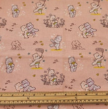 Care Bears Nursery Cotton Print - Care Bears and Flowers on Peach - per half metre