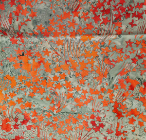 Sew Simple Stamped Batik Fabric - Orange Floral on Grey - per half metre