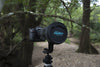 Image of lens soft cap in forest