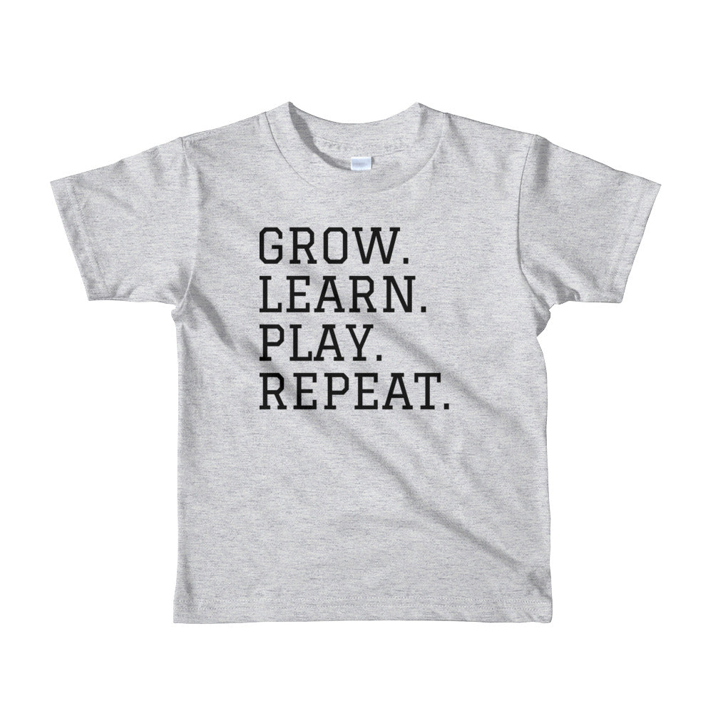 GROW. PLAY. LEARN. REPEAT. Short sleeve kids t-shirt