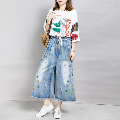 Embroidered Triangle Frayed Burr Casual Jeans