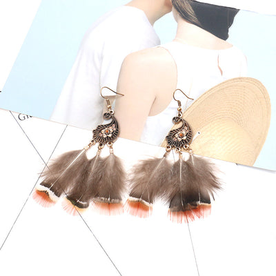 Peacock-studded pierced feather earrings