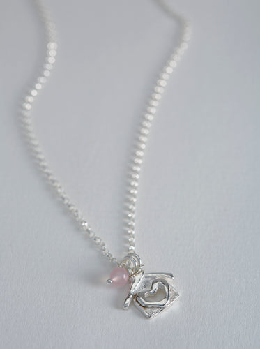 Handmade exclusive Silver Charm & Rose Quartz necklace designed by Natasha Salkey