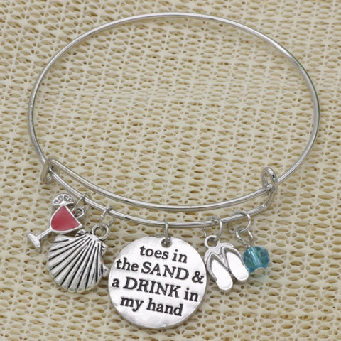 silver motivational bracelet (toes in the sand)