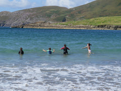 Family swimming off an uninhabited island in the West of Ireland