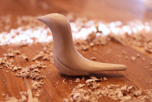 WOODEN BIRD WHITTLING