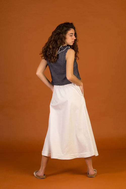 Long skirt with thin casing. White colour