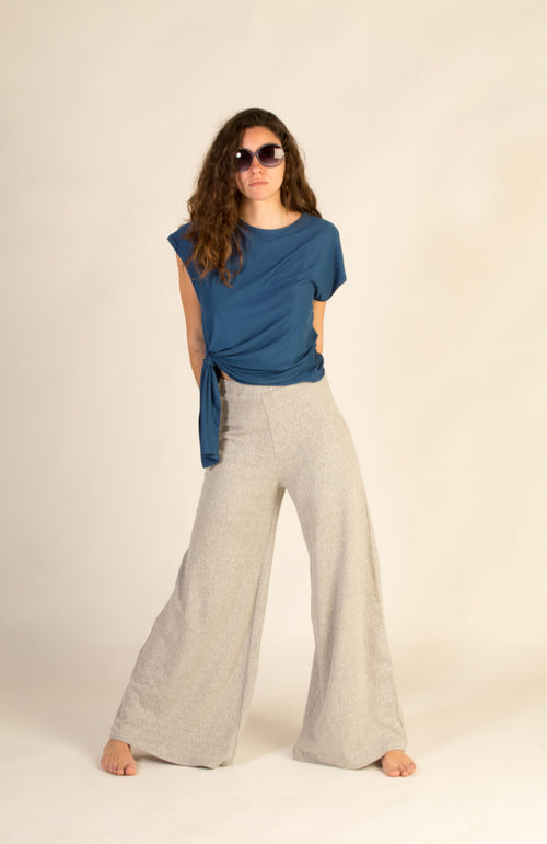 Flared trousers. Grey openwork knit.