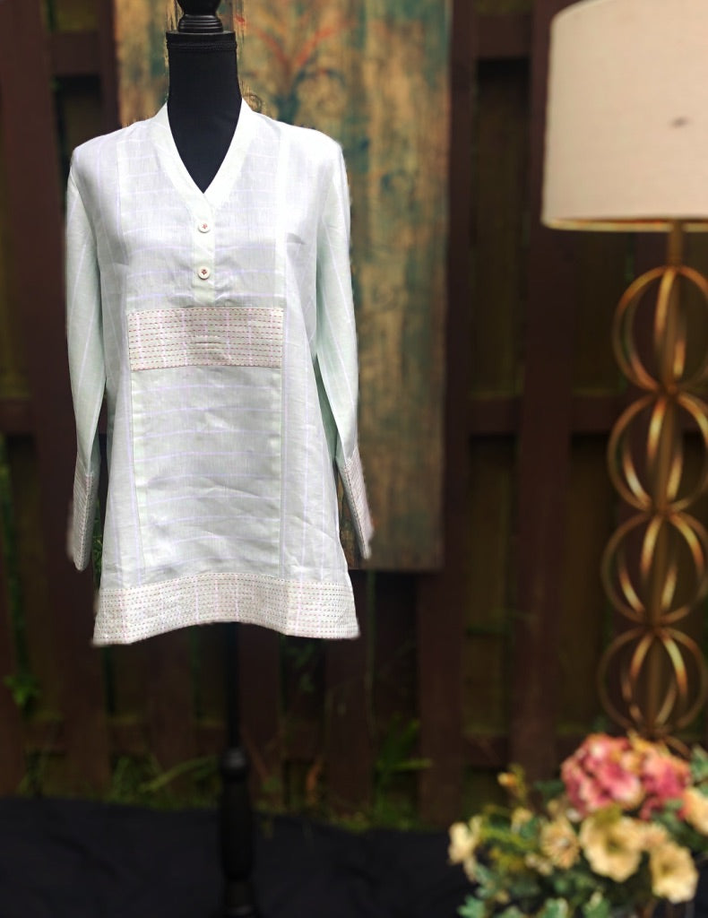 Pale green tunic with intricate stitch detail. The fit, the longer hemline and long sleeves will satisfy your modesty and style needs. Be stylish. Be modest. Wear Thread Palette London.