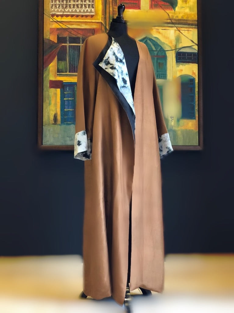 Be the showstopper in this gorgeous silk abaya. Fulfilling all your modesty and style needs  all in one.