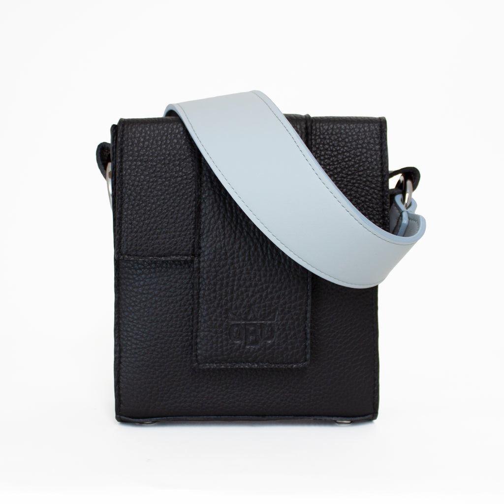 Blue/grey, steel blue, pale blue, ice blue, bluish grey, greyish blue strap on a black Italian leather luxury handbag. Crafted in Scotland and designed by an Irish accessories designer.