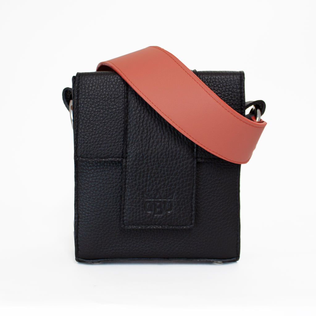 Coral leather strap for a cross body black leather bag. Beautiful soft Italian leather with an Irish linen lining. Designed in Connemara, Ireland and made in Scotland.
