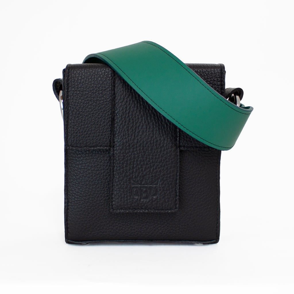 Gorgeous green strap on a structured black leather handbag. QBU a new Irish accessories brand. Designed in the west of Ireland and made there and in Scotland. Small batch production. Ethical fashion. Design your own bag. Italian leather and Irish linen.