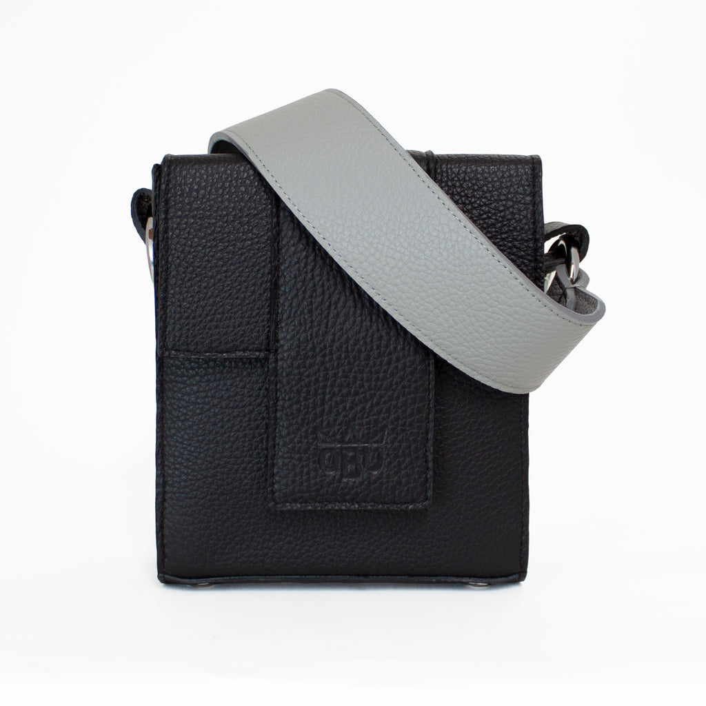 Grey strap with a black bag. Perfect for a night out at a gig. Vegetable tanned Italian leather. Irish designer.