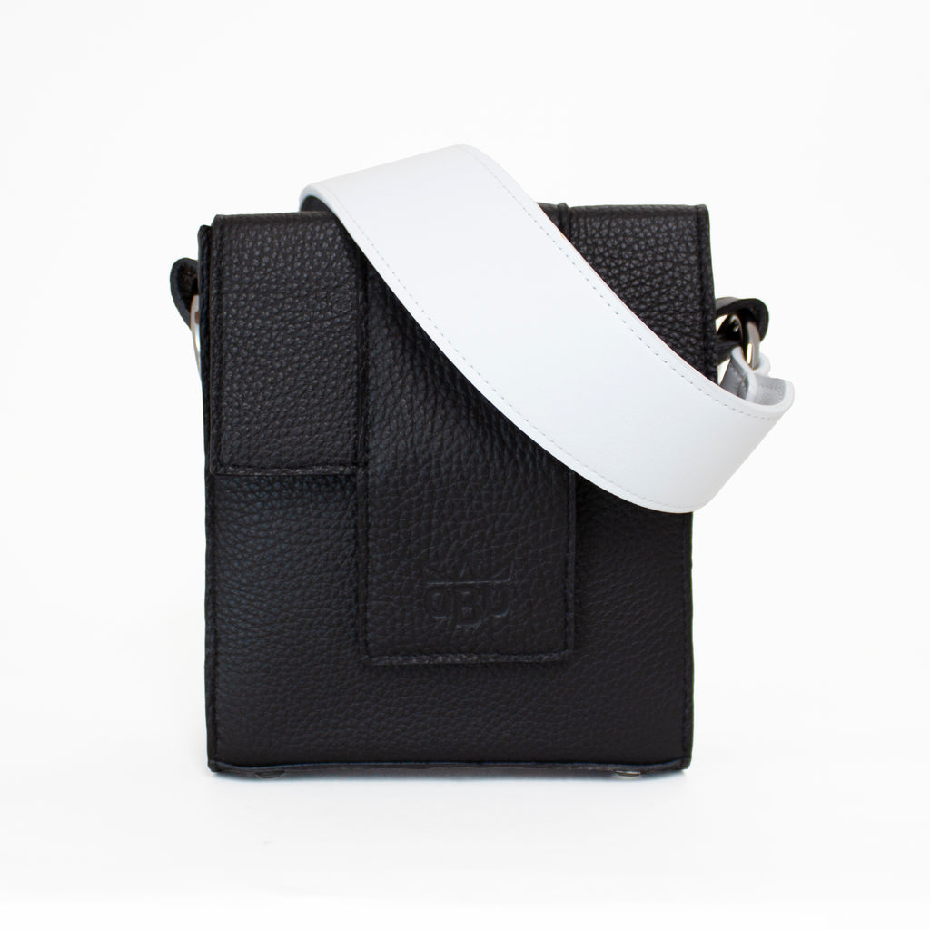 Black leather handbag with stunning white strap. Monochrome. Irish design. Made in Europe.