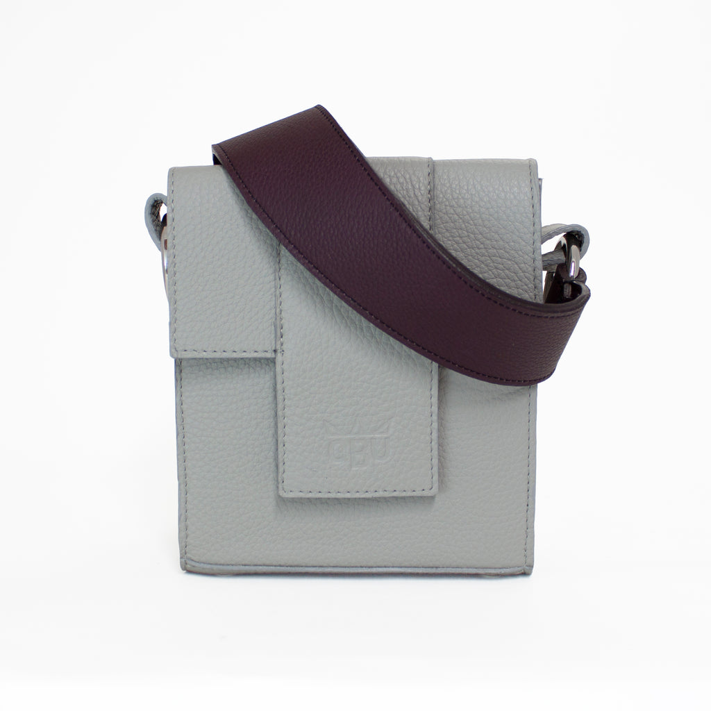 A cool grey handbag with a warm deep purple strap. Design your own bag with this new Irish brand. Made from Italian leather and all European materials.