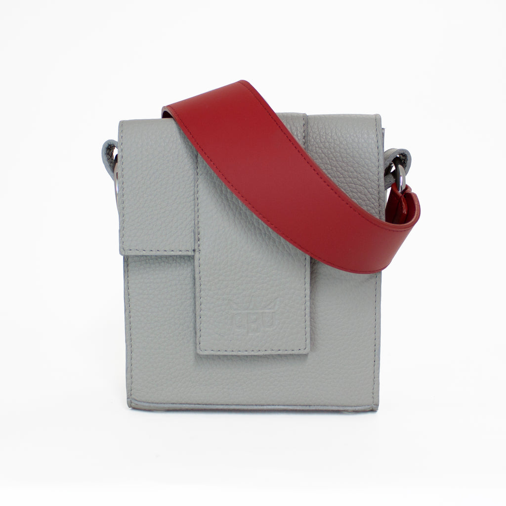 Lipstick red handbag strap with a cool grey bag. A bag to dress up any outfit. Luxury European materials. Ethically made in Scotland. Designed in Ireland.