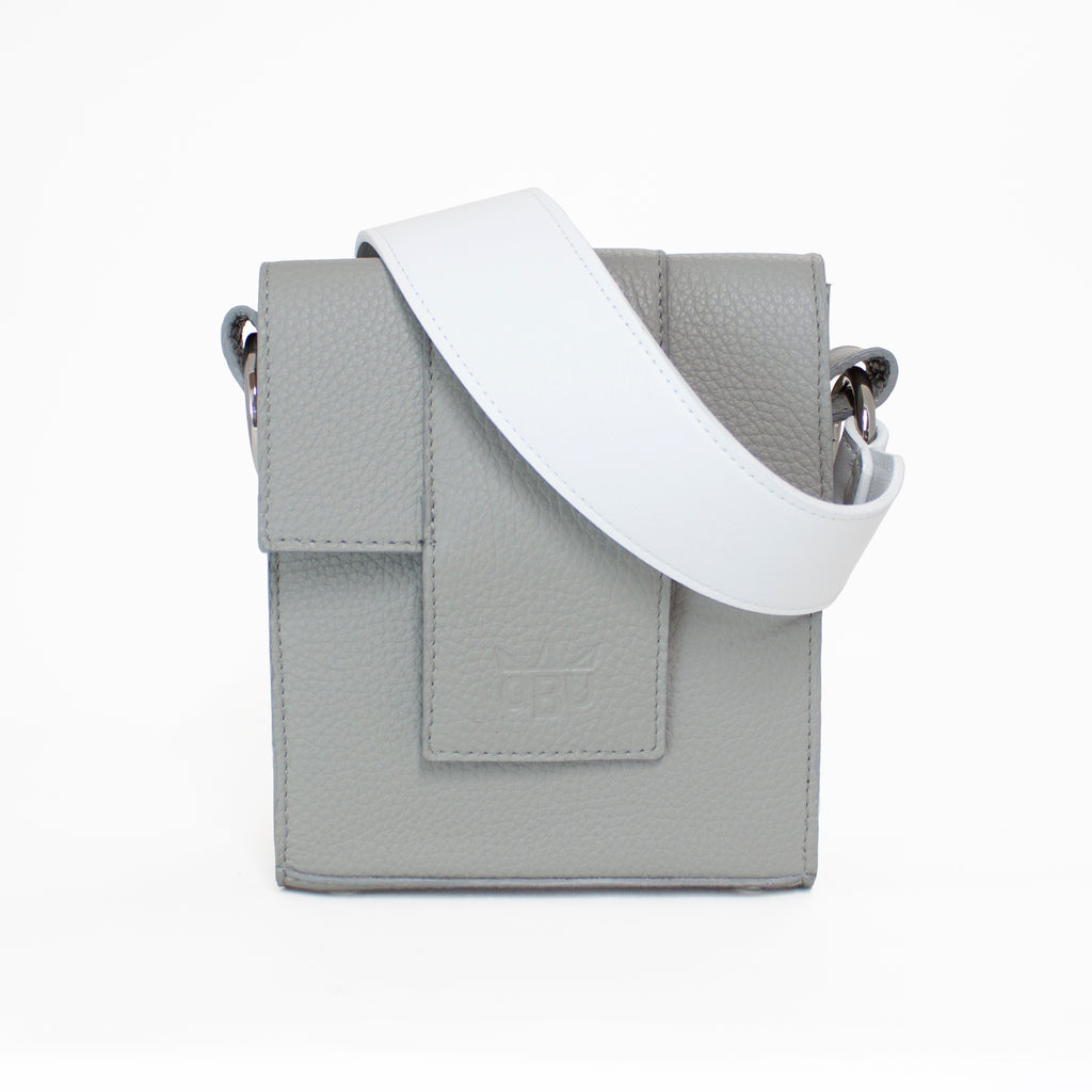 Amazing grey bag with white strap. Great crossbody handbag for every day. Made from luxury materials in an ethical fashion. European materials and manufacture. New Irish accessories brand.