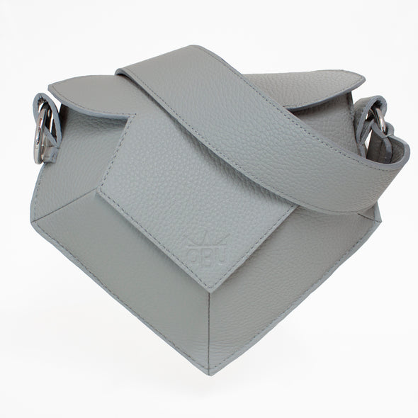 Grey angular handbag. Style this exclusive handbag your way by choosing your own strap to go with it.