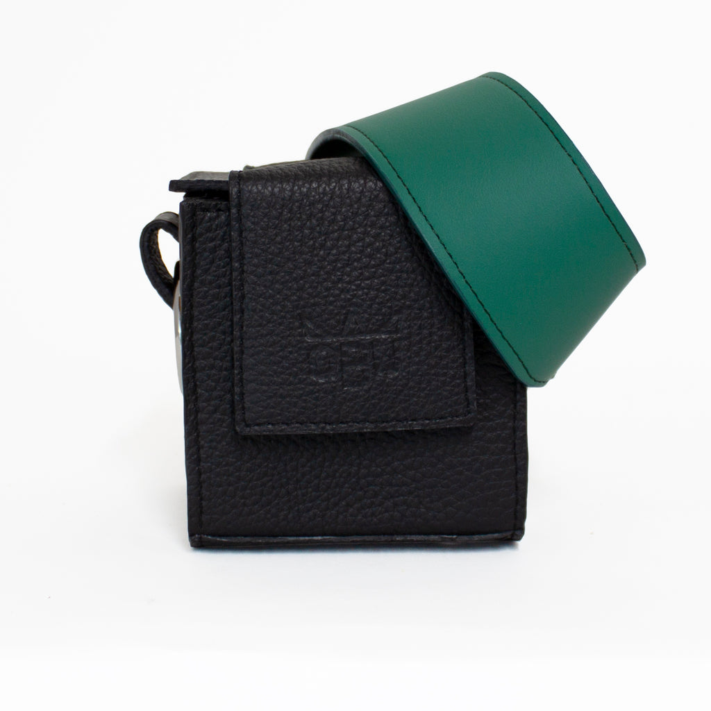 Forest green handbag strap on a small black cube shaped handbag. Made from beautiful zero-impact Italian leather in Scotland.