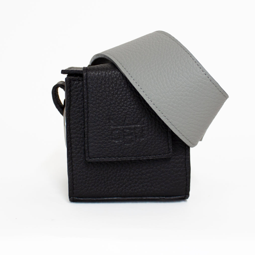 Black handbag with a cool grey strap. Choose your own colour strap. Italian zero-impact leather and all other European materials. Designed in the west of Ireland.