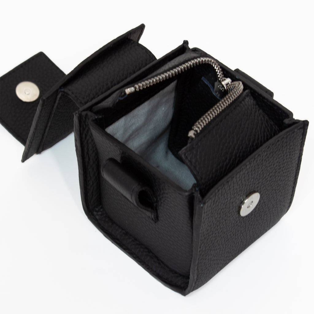 Inside view of small cube handbag. Swizz zip, Irish linen lining. European manufacture. Irish brand.