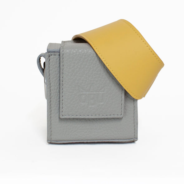 Cute grey bag with a yellow strap. Cube design handbag. Designed in Ireland and made in Scotland from Italian leather.