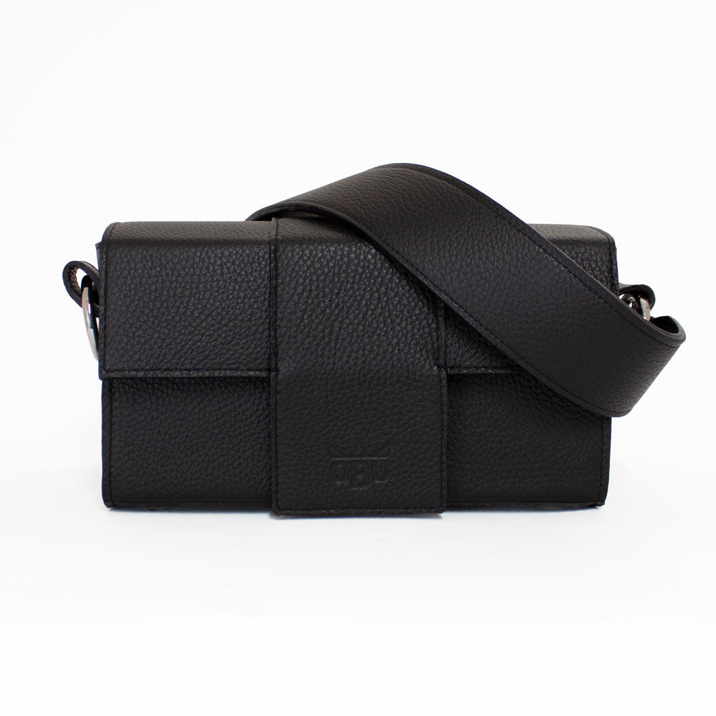 Cool new accessories brand from the West of Ireland. QBU's Kelly Kania Handeldiss bag is customisable so you can have a black strap and a black bag like in this picture or pick a different colour strap to change it up a bit.