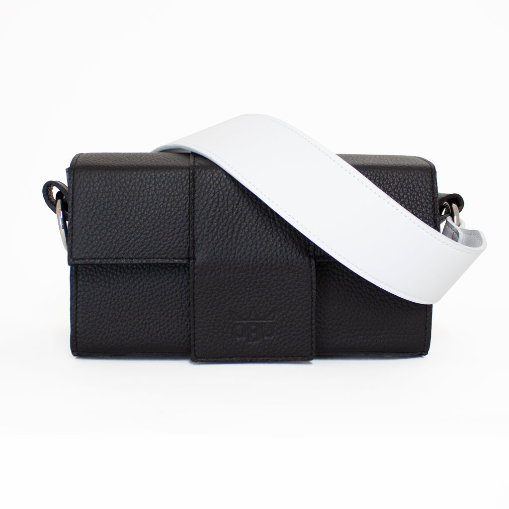 Black and white leather. Shocking white strap on a black handbag. Customise your own bag by choosing whatever strap you want. Italian sustainable leather.
