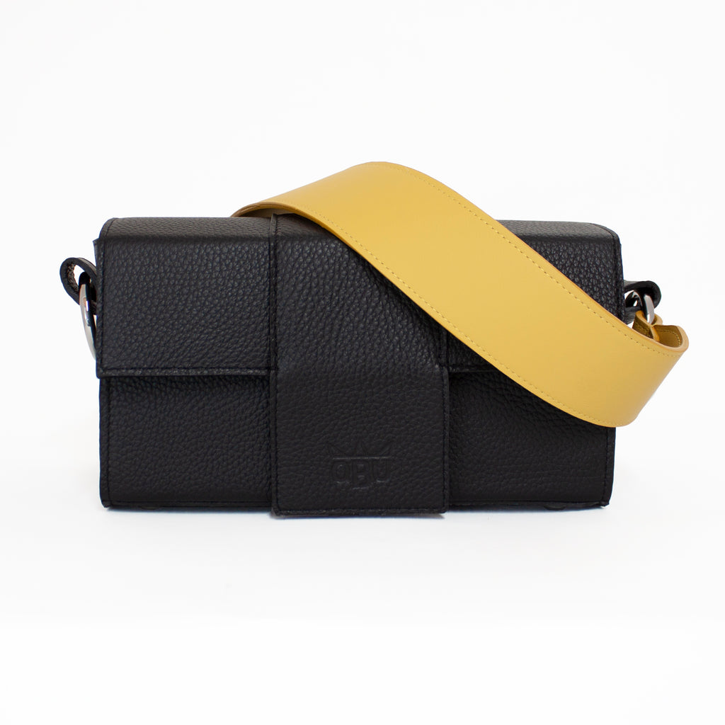 Yellow leather strap teamed with a black leather handbag. Contemporary Irish accessories. QBU is bringing you buildable handbags. Supports ethical fashion by producing in small production runs in Scotland.