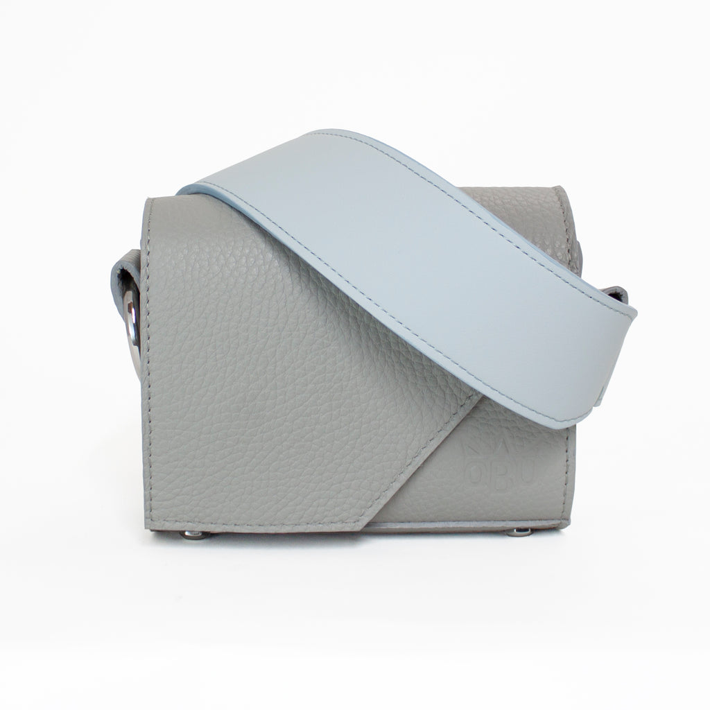 Cool grey bag with an ice blue strap. Stay tonal with this Irish designed ethical leather handbag.