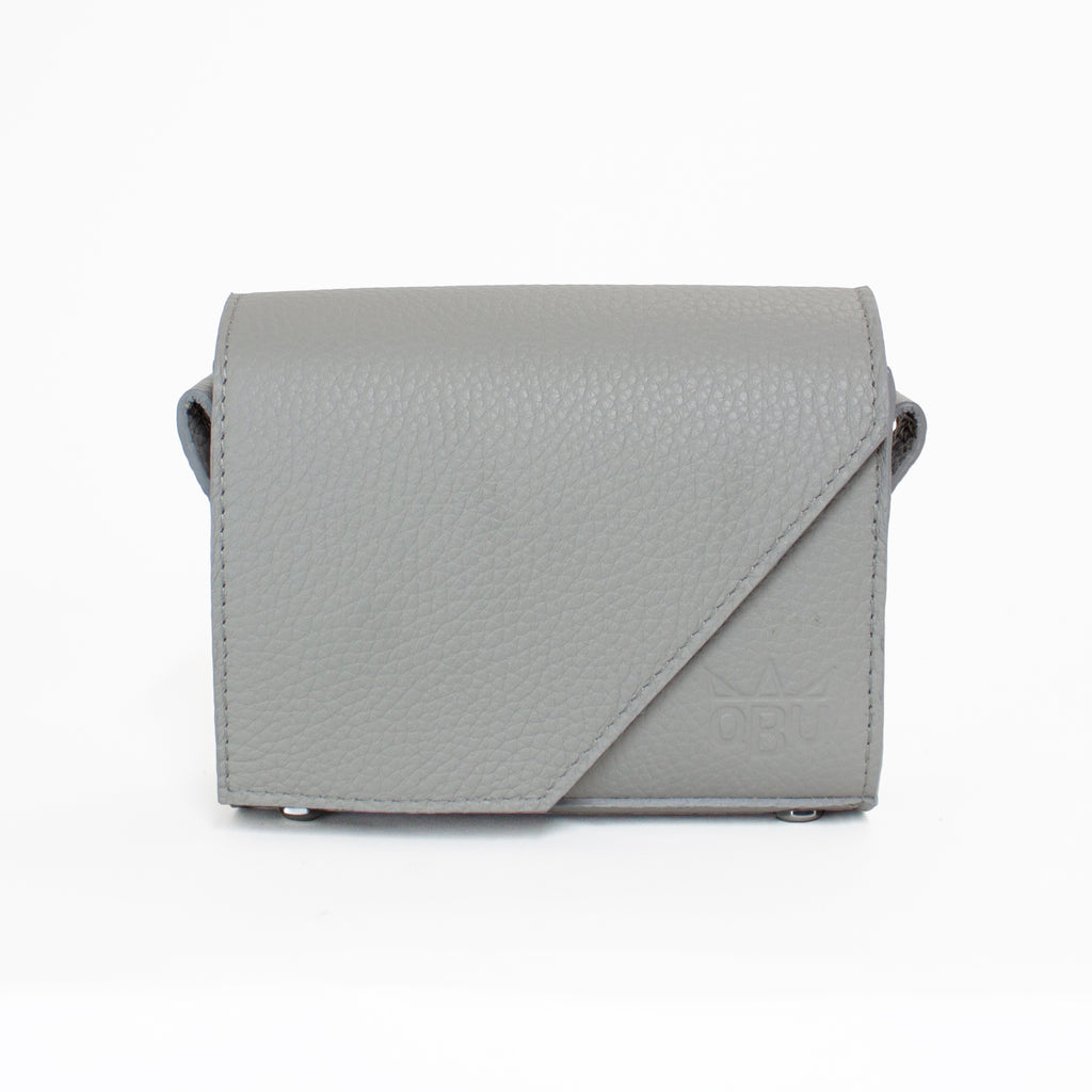 Geometric, corner cut off small grey bag. Customise it with you own strap choice. Choose strap from ten colours.