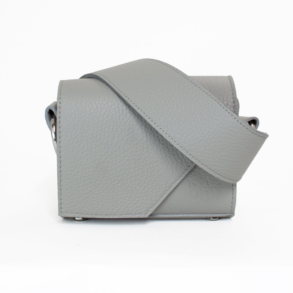 Beautiful small leather grey bag. New and edgy Irish accessories brand QBU is letting you design your own bag. Choose from ten colours to mix and match and match your handbag strap. Keep it classic with the same colour.