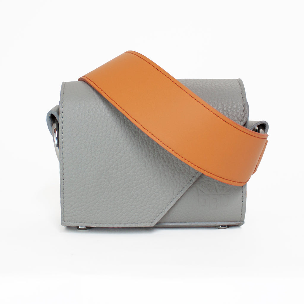 Grey and orange handbag and strap team. Design your own hot bag of the season by teaming this bright orange strap with a light grey handbag. Small crossover handbag perfect for an occasion.