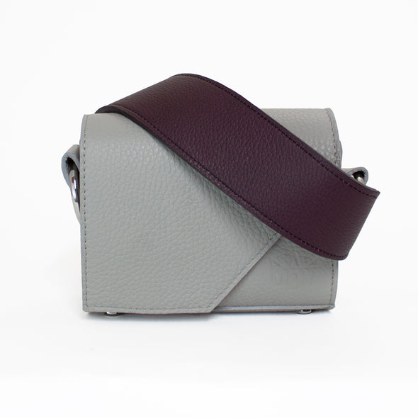 Small cool grey bag with a deep rich purple strap. Perfect bag for a night out. Fits your essentials.
