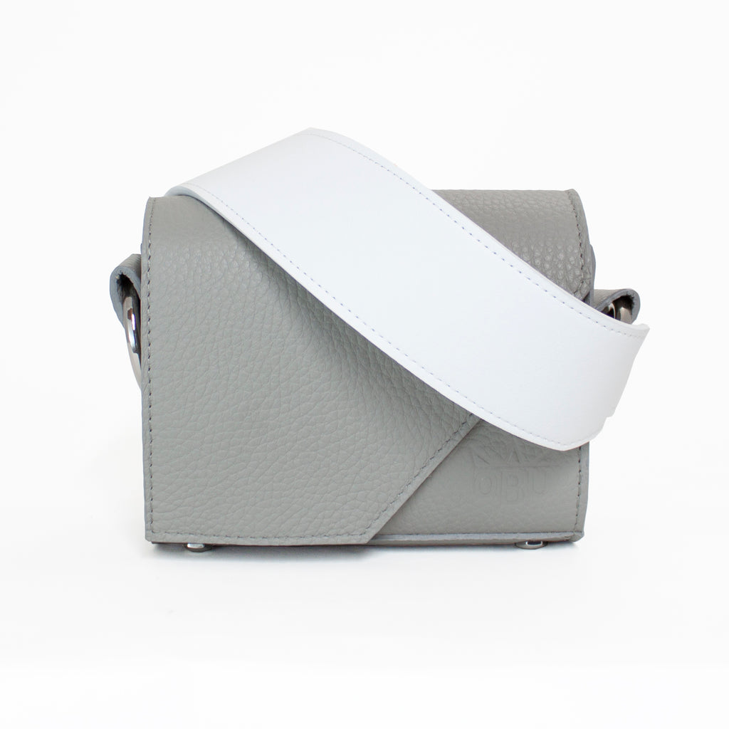 Amazing design in this cool grey leather handbag with a shocking white strap. Would be great as a cool bridal bag. Unique design as you design your own bag.