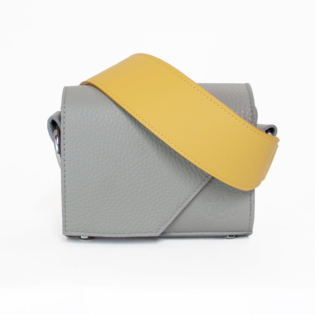 Yellow and grey leather handbag and strap. This bright yellow handbag strap will liven up any outfit with the cool grey perfect to match whatever you are wearing. Small crossover Oma bag is perfect for fitting your phone, a small purse and your keys. New accessories brand.