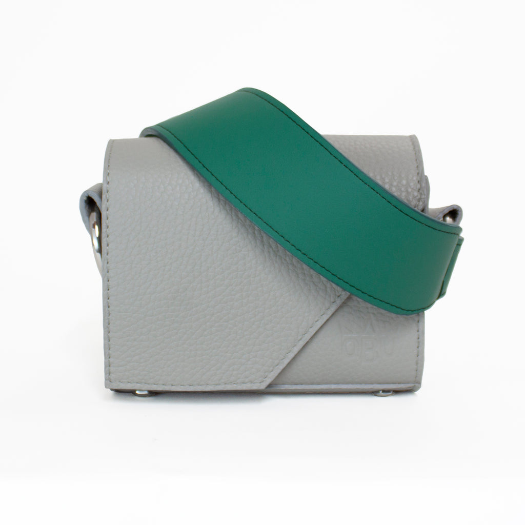 Gorgeous green handbag strap with a cool geometric small handbag. Customise your QBU bag with a choice of ten brightly coloured straps. A bag that dresses up any outfit.