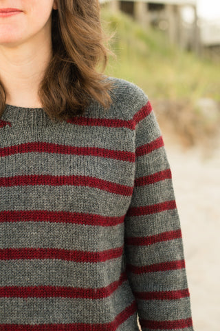 red and gray striped sweater