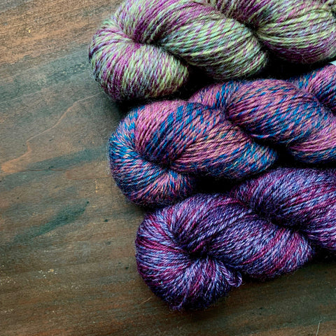 skeins of purple wool yarn by Queensland Collection