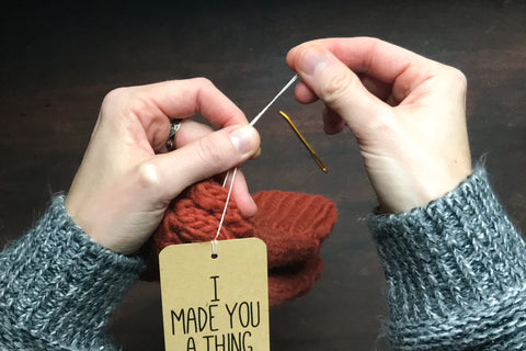 How to attach a tag to a hand knit gift