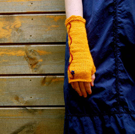 gold fingerless mittens with a blue dress