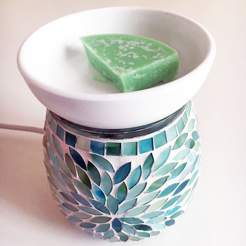Flame free fragrance in an electric wax warmer
