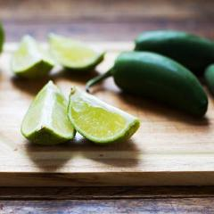 jalepeno and limes on wood cutting board