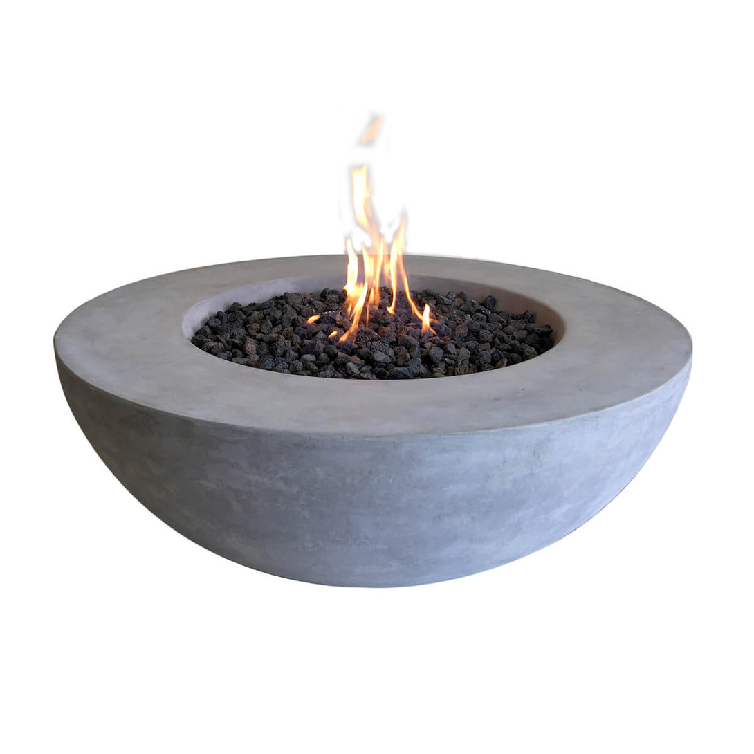 Hollowed out concrete half sphere with a fire pit in the center