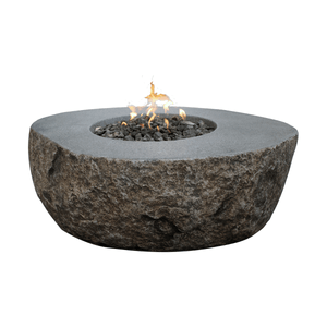 hollowed out boulder with a flat top and a fire pit in the center