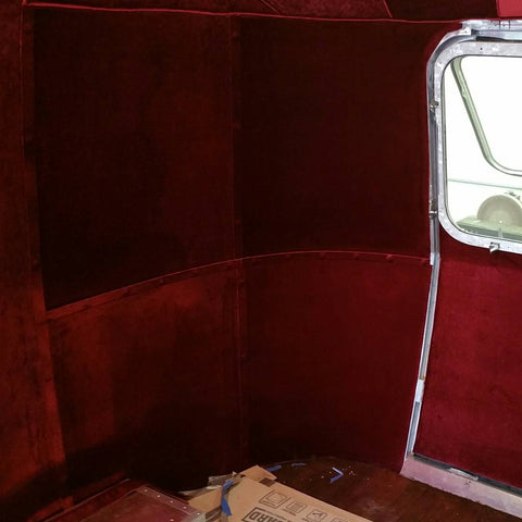 Custom velveteen wall covering in an Airstream