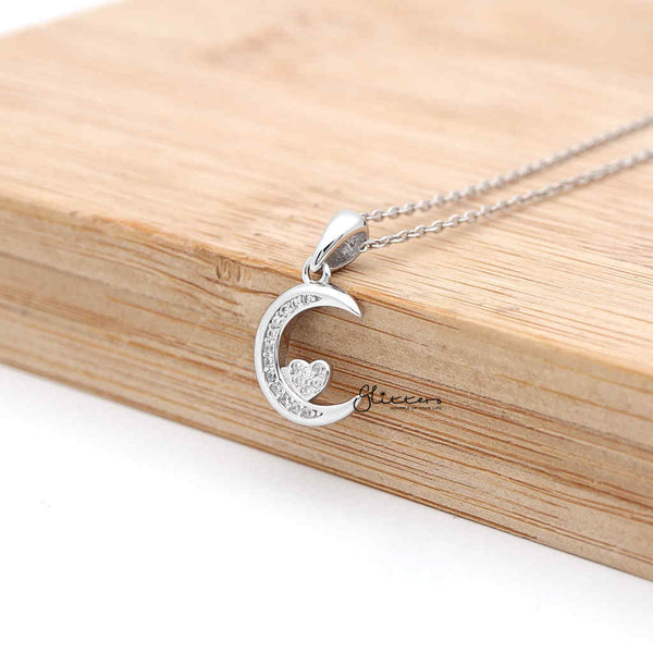 Sterling Silver CZ Paved Moon with CZ Heart in the Middle Women's Necklace